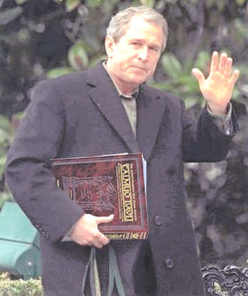 http://www.texemarrs.com/images/bush_with_talmud.jpg