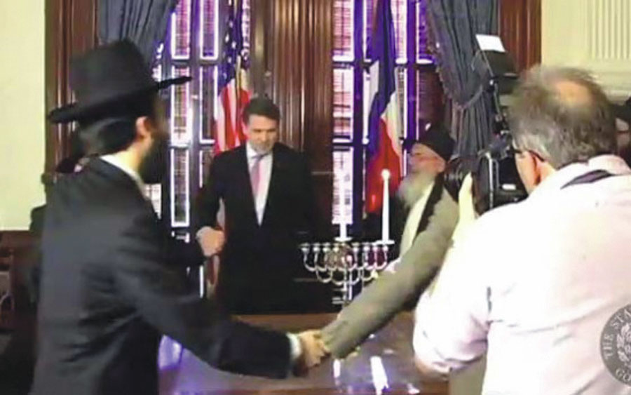 Rick Perry dancing with rabbis in the Governor's office