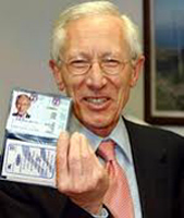 Stanley Fischer shows off his ID card